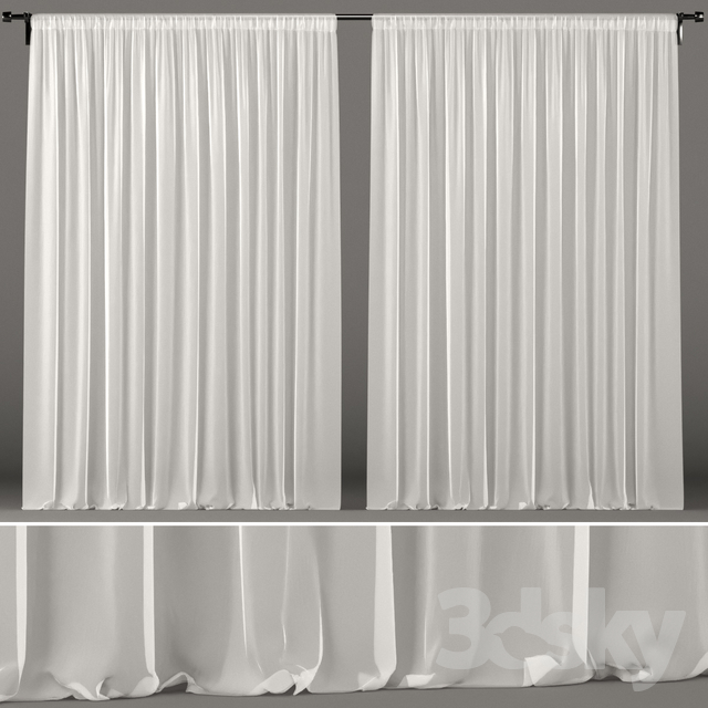 Sheer white tulle curtains.