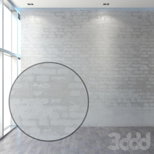 Отштукатуренная кирпичная стена