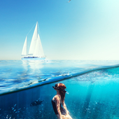 Looking at her, I could see white sails and blue water.