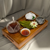 Tray with tea, napkins, mint leaves and lily