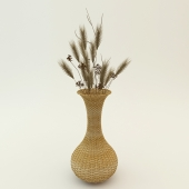 Wicker vase with dried flowers