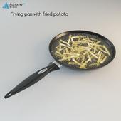 Frying pan with fried potato