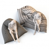 Triangular chair cushions with mannequins