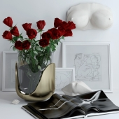 Set with roses, marble bust and lips