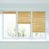 Bamboo roll blind and plastic window