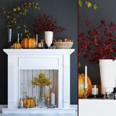 Artificial fireplace with candles and autumn decor