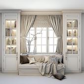 Мягкая зона у окна - диван с подушками, пледом, шторами, шкафами и декором.