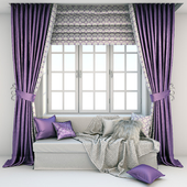 Мягкая зона у окна - диван с подушками, пледом и шторами