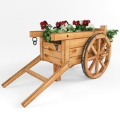 A cart under the flowers.
