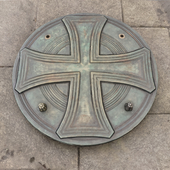 Manhole cover with cross figure