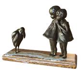 Ancient sculpture children with a bird