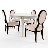 Oval dining table with sliding chairs