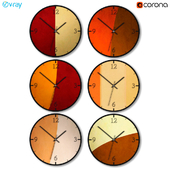 A set of wall clocks with geometric figures.
