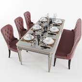 Dining table with with chairs, banquet and dishes