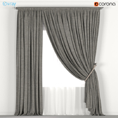 Dark curtains with a garter on the rope and tulle.