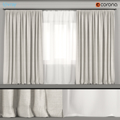Gray wide curtains with white tulle.