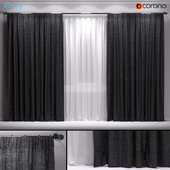 Dark blackout curtains with tulle.
