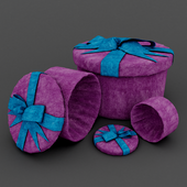 Set of round gift boxes with ribbon