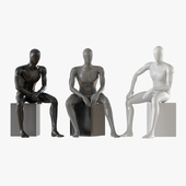 Three seated faceless mannequins 13