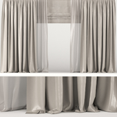Brown curtains with tulle and roman blinds.