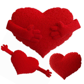 A set of knitted pillows in the shape of a heart