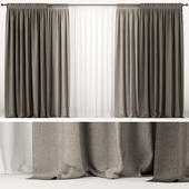 Wide brown curtains in two shades with white tulle.