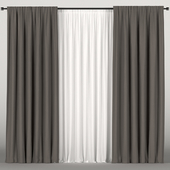 Dark brown curtains with tulle.