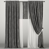 Dark gray curtains in the background with tulle and Roman curtains.
