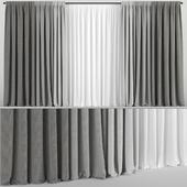 Gray curtains in three shades with tulle.