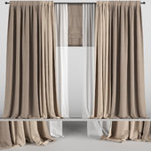 Brown curtains in two colors with tulle and roman blinds.