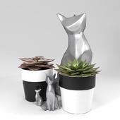Pot succulent plants with fox metal sculptures