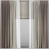 Curtains in two colors with tulle and roman blinds.