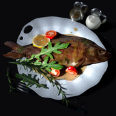 Baked fish in sauce with vegetables
