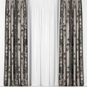 Коричневые шторы с тюлем.