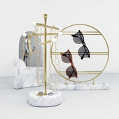 A set of stands for jewelry and glasses with a mirror.