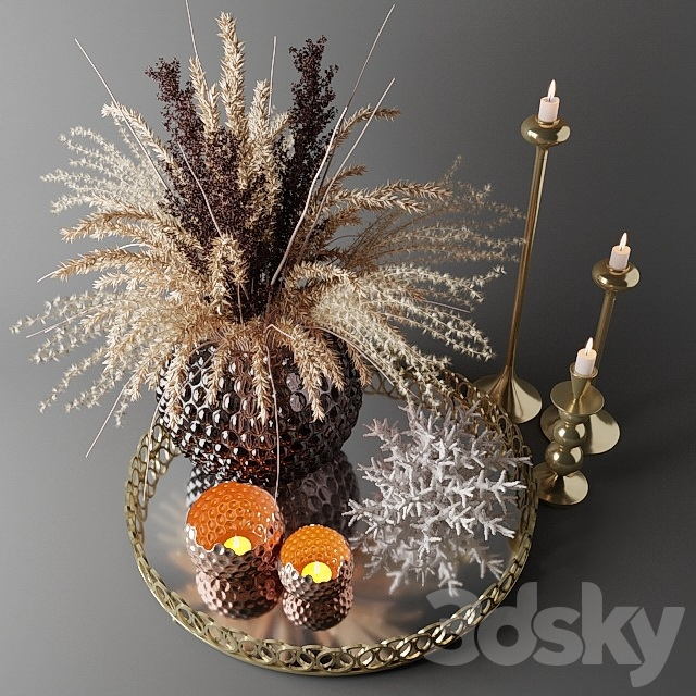 Bouquet of dried flowers in a glass vase on a tray