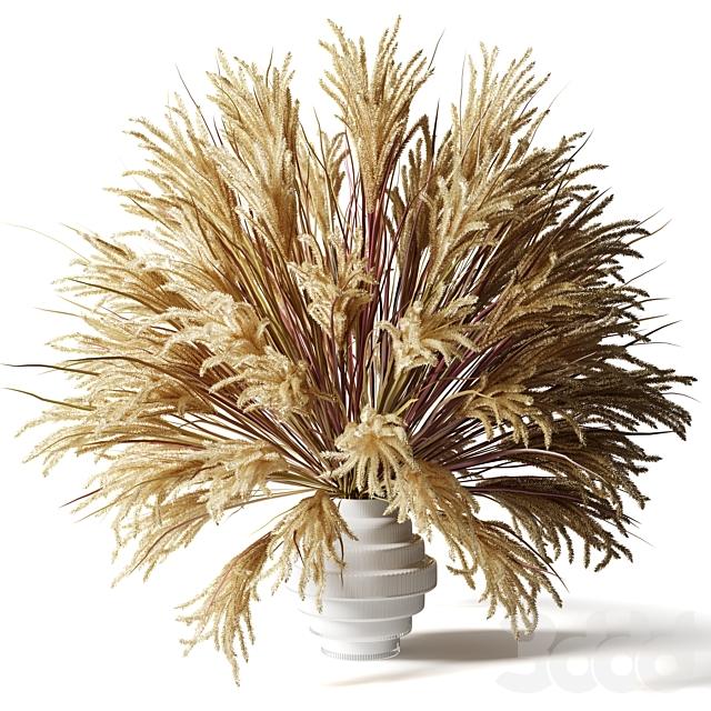 Пушистый букет из сухой травы с хвостиками в стеклянной белой вазе